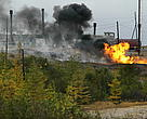 Burning oil-gas by the Sakhalinneftegaz state company. Sakhalin Island on the Sea of Okhotsk, Russian Federation.