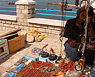 Tabarka, Tunisia.  Souvenirs and Red coral for sale. It might well be fake coral as the price is very low. Since antiquity Tabarka has been famous for its coral fishing and the Coral Festiva