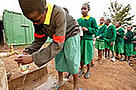 School girls filling water bottles at a water tap. Nairobi City, Kenya / &copy;: WWF-Canon / Martin HARVEY