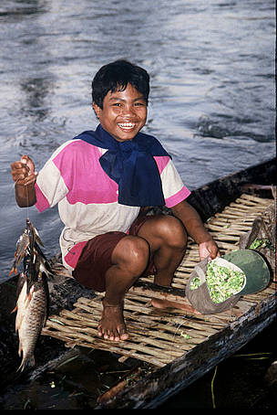Tribal boy collects family supper: wild flowers and fish from the Serepok River in the Mekong River ... / ©: WWF-Canon / Elizabeth KEMF