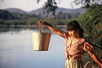 Tribal girl collecting water from the Srepok River, Vietnam. / &copy;: WWF-Canon / Elizabeth KEMF