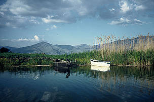Fishing boats, wet meadows, and reeds. Prespa lakes, Greece.  / &copy;: WWF-Canon / Georgia VALLAORAS