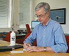 Jim Leape, WWF International Director-General, writing postcards to rangers under the WWF Tigers Alive Initiative's Cards4tigers action