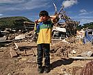 Child standing in the debris of Hurricane Mitch Tegucigalpa, Honduras.