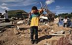 Child standing in the debris of Hurricane Mitch Tegucigalpa, Honduras. © WWF-Canon / Nigel DICKENSON
