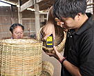 Staff is testing percentage of moisture of the rattan basket before going to another quality controlled stage