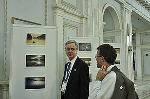 Jim Leape, Director General of WWF and Andreas Beckmann, WWF Danube-Carpathian Programme Director viewing a WWF exibition at the Ramsar COP, Bucharest, Romania, 2012.