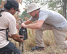 Leonardo DiCaprio installing a camera trap in Bardia National Park.