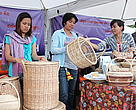 Ms Att Sreynak (second from left to right) admires a rattan basket at One village One Product fair.