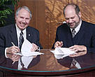 Monte Hummel, President of WWF-Canada, and John W. Weaver, President and CEO of Abitibi-Consolidated Inc., sign agreement on joint forestry conservation programme.
