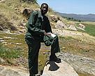 WWF Prince Bernhard Scholar, Absalom Shigwedha, in nature uniform and boots during a field identification and ecological monitoring safari in Tanzania's Lake Manyara National Park