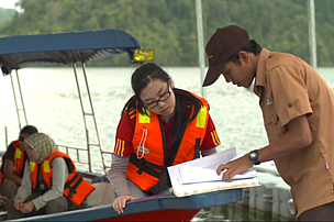 Ranger Khairul with tourist, Royal Belum State Park, Malaysia
