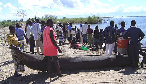 Waiting for fishermen to bring a day's catch to the shore on lake Malawi. rel=