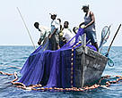 Both WWF and IUCN are working in Africa to secure fish stocks. Fishermen pulling up nets, Mafia Island, Tanzania.