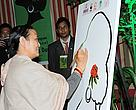 Chief Guest Anuradha Koirala inaugurates the event by painting the outline of a female face