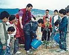 Students putting environmental education into practice,Yunnan Province, China.<BR>