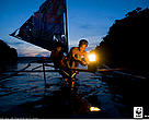 "A local two man sailboat out for night fishing using a kerosine ""Petromax"" lamp to attract fish, Camarines Sur, Bicol, Philippines, Coral Triangle"