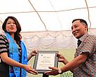 Dr Ghana S Gurung, Conservation Program Director of WWF Nepal handing over the plaque to Ishani,the newly appointed Young Conservation Ambassador