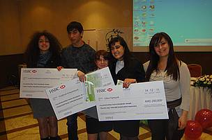 Winners of the essay competition holding HSBC cheques to implement their project proposals