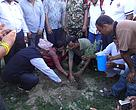Honorable Minister for Forests and Soil Conservation, Mahesh Acharya planting a saplings of Khair-Sissoo.