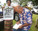 Signing the petition at Rewa Day