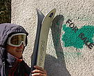 A person poses as a skier at a street action against illegal ski runs in Vitosha Nature Park
