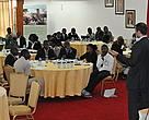 Delegates listen to a presenter during the Extractive Industry Transparency Initiative (EITI) conference in Nairobi on 4th December 2012 