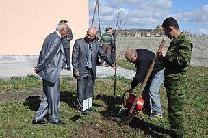 Tree planting behind the administrative building of the park