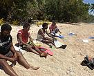 Before diving into the lagoons off Mali island, survey team gets pointers on species and reefs