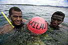 Naduri village youths with the buoy that marks the boundary of the new marine protected area. / ©: Brent Stirton / Getty Images / WWF-UK
