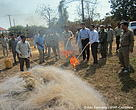 His Excellency Nao Thouk, Director of the FiA, together with WWF representatives, local government representatives, commune chiefs, police and river guards, light up a pile of confiscated gillnets in a public burning ceremony at the Koh Sampeay outpost in Stung Treng. A similar ceremony was held in Kampi, Kratie Province, the following day.