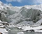 The cracking - and - retreating snout of Gangotri Glacier.  But smaller glaciers and significantly, their tributaries, are retreating faster in the face of climate change
