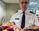 Grant Miller with elephant ivory bracelets and other ivory trinkets seized by UK Border Force.