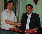 Dr K. C. Poudel, DG  Department of Forests and Mr. Anil Manandhar , CR  WWF Nepal shake hands after signing the grant agreement. 