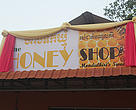 Honey Processing and Trading Center shop sign.
