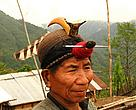 A hunter of the Nishi tribe of Arunachal Pradesh with a Great Hornbill casque in his cap.