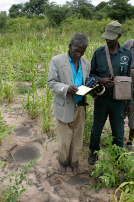 Local farmer Moses Maseku is made to sign the protocol in the Conservancy's Event Book by an ... / ©: WWF-Canon / Folke WULF
