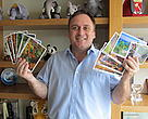 Mike Baltzer, Leader, WWF Tigers Alive Initiative with postcards he is sending to tiger rangers highlighted in the Cards4tigers initiative