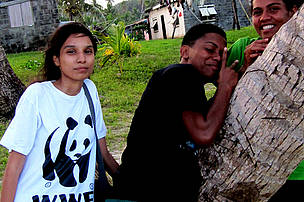Volunteers Zhera and Kara, in the middle, on Gau island 