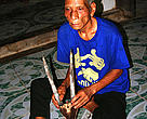 Briu Bia, 79, Katu hunter with saola trophy.
