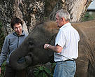 Dr. Andrew McLean and Tuikku Kaimio attend a baby elephant