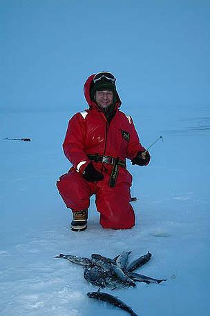Tom Arnbom and the catch of the day - arctic char. Chukotka, Russia. / ©: Viktor Nikiforov