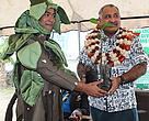 Tiri the Mascot for the Mangrove Campaign hands over a mangrove plant to the Minister for Environment Colonel Samuela Saumatua to plant on the banks of the Lami creek launching Fiji's National Mangrove Awareness Campaign 