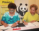 WWF-Pacific Representative, Kesaia Tabunakawai (in blue), and PIANGO  Executive Director, Emele Duituturaga, formalising the MoU