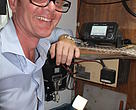 Sea Quest (Fiji) Limited owner Brett Haywood beside the AIS Unit that easily transmits to nearby ship or AIS base stations ship locations aiding transparency in tuna fisheries