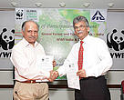 Mr. Ravi Singh SG & CEO WWF-India holding the signed agreement along with Mr. Pradeep Dhobale Divisional Chief Executive, ITC Limited.