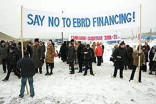 A group of people holding a banner with the words &quot;Say No to EBRD Financing&quot; / &copy;: Sakhalin Environment Watch