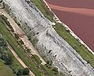 A June 2010 aerial photograph of the wall of the Kolontar sludge reservoir clearly shows damage and leakage - three months before dam walls breached, killing seven, covering 40 sq km with toxic red sludge and sending a plume of caustic pollution down rivers into the Danube.