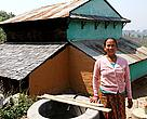 Laxmi Rana in front of her house in Jumdanda