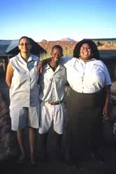 Pascoleno Florry, Damaraland Camp, at right, with members of her staff from the Torra Conservancy. / &copy;: WWF-Canon / Jan Vertefeuille